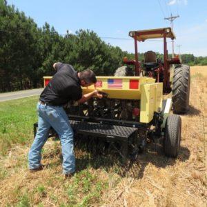man adjusting drill settings
